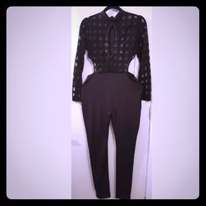 Pants - Black jumpsuit with side opening.